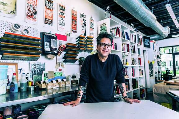 Carlos Hernandez pictured at Burning Bones Press, a printmaking studio he runs with Christopher Masterson.