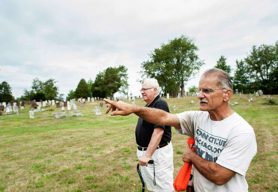Archaeologist Nick Bellantoni, right, and Augie DeFrance, president of the Middletown Old Burying Grounds Association, work in Middletown on one of Bellantoni's last official projects with the state. Photo: Erin Covey / Associated Press / Republican-American