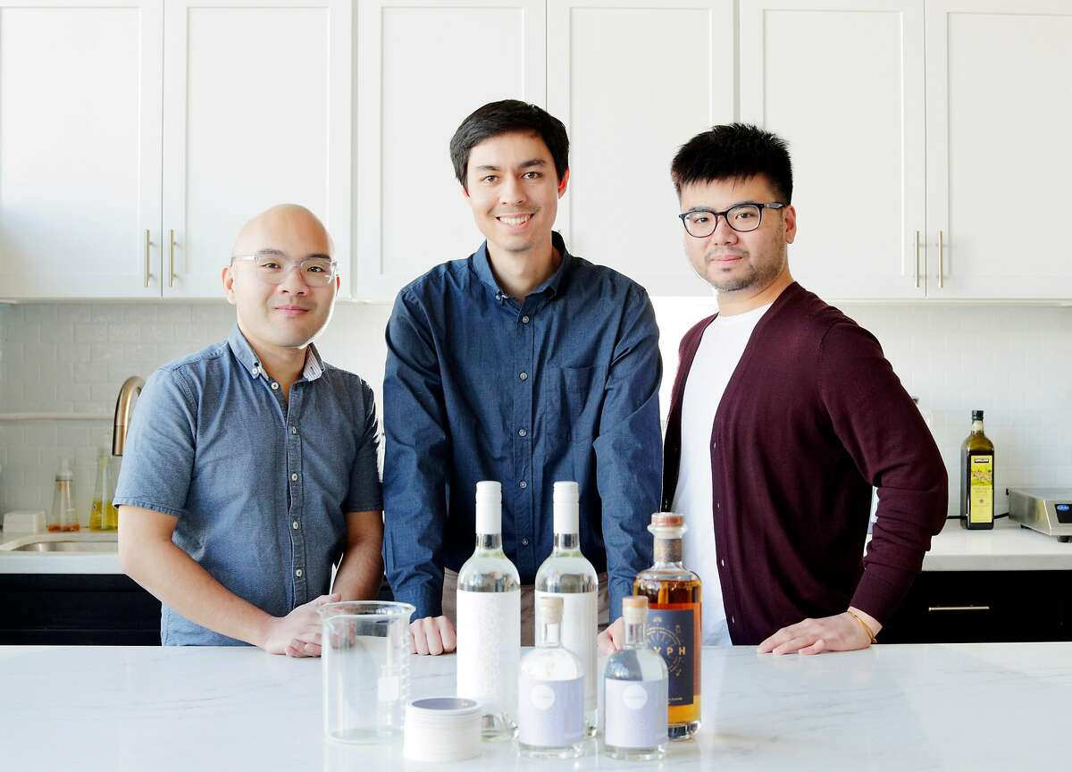 """L-R, Josh Decolongon , Co-Founder and Chief of Product, Alec Lee, Co-Founder and CEO, Mardonn Chua, Co-Founder and CTO, at the headquarters of Endless West, a startup where they are developing """"molecular"""" wines, whiskey, and sake in San Francisco, Calif., on Monday, February 10, 2020. Endless West produces the beverages in a lab, not from plant materials. After years of development, the company is finally ready to debut the wine and sake prototypes."""