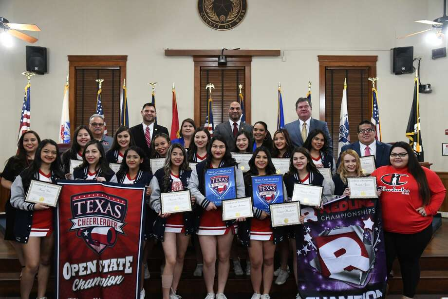 The Martin High School Cheerleading Squad pose with their recognitions and banners during a Webb County Commissioners Court meeting on Monday, Feb. 10, 2020. Photo: Christian Alejandro Ocampo/Laredo Morning Times