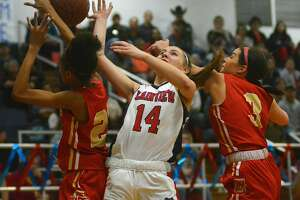 Plainview's Katy Long tries to get the shot off against a pair of Lubbock Coronado players during their District 3-5A girls basketball game on Monday, Feb. 10, 2020 in the Dog House.