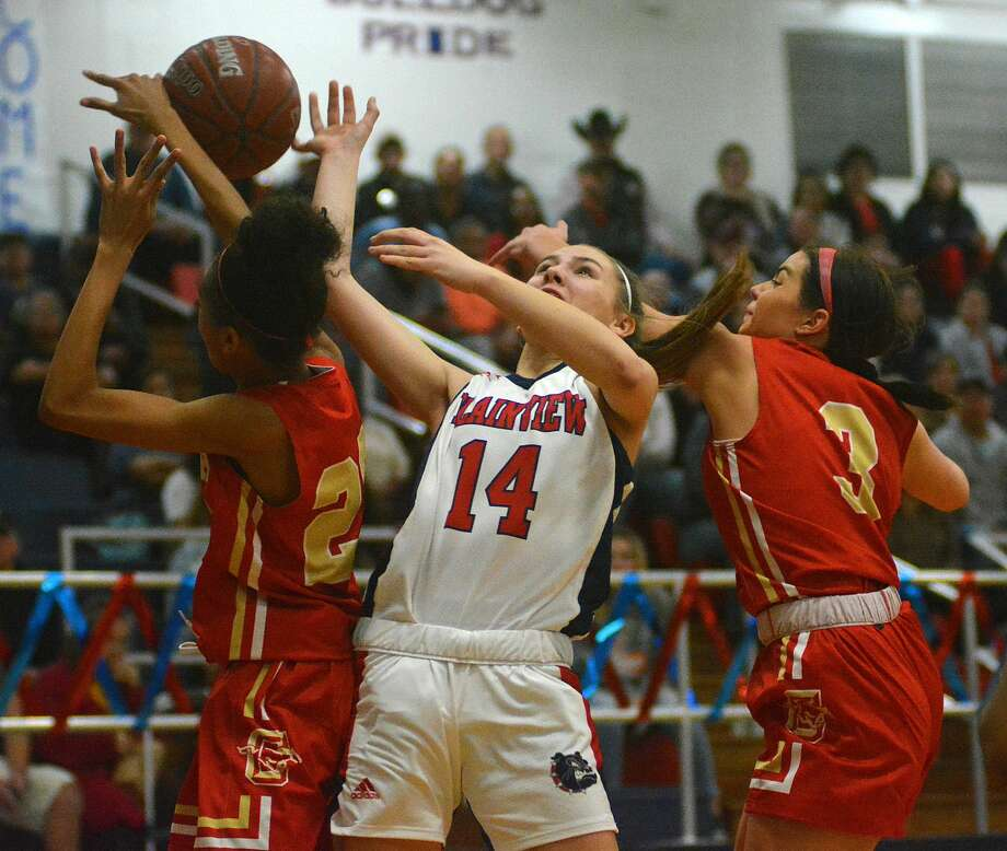 Plainview's Katy Long tries to get the shot off against a pair of Lubbock Coronado players during their District 3-5A girls basketball game on Monday, Feb. 10, 2020 in the Dog House. Photo: Nathan Giese/Planview Herald