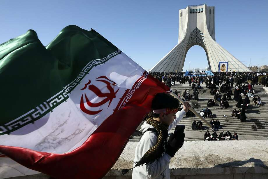 A boy carries an Iranian flag in a really to celebrate the 41st anniversary of the 1979 Islamic Revolution in Tehran. Photo: Vahid Salemi / Associated Press