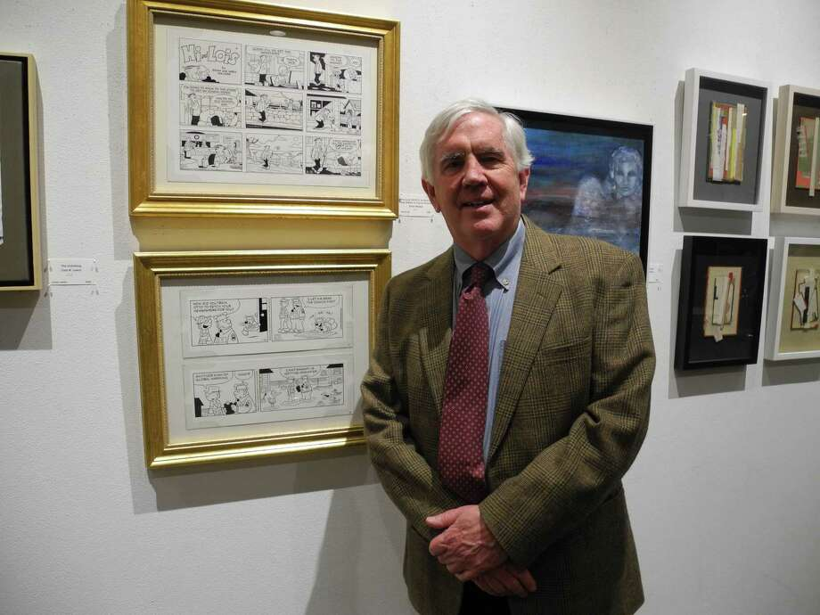"""Brian Walker of Wilton stands with two panels of the cartoon strips """"Beetle Bailey"""" and """"Hi and Lois"""" that he works on with his brothers Greg and Neal Walker and Chance Browne. Photo: Jeannette Ross / Hearst Connecticut Media / Wilton Bulletin"""