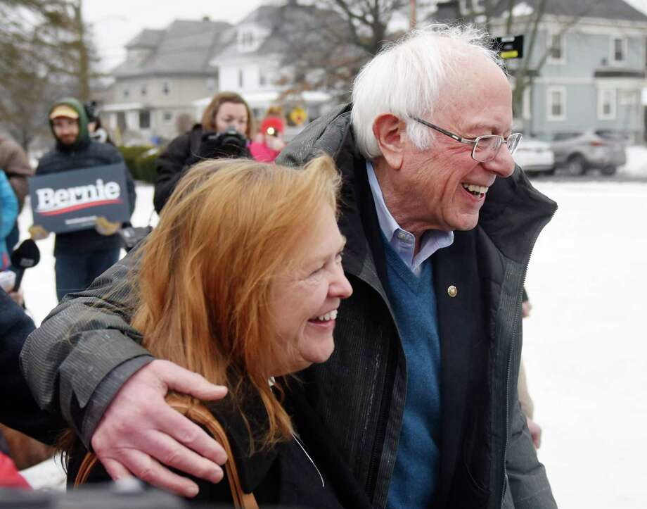 U.S. Sen. Bernie Sanders, I-Vermont, campaigns with his wife, Jane O'Meara Sanders, during the New Hampshire Presidential Primary at McDonough School in Manchester, N.H., on Tuesday. Photo: Tyler Sizemore / Hearst Connecticut Media / Greenwich Time