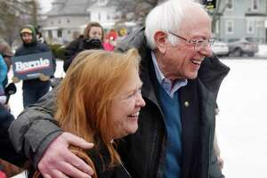 U.S. Sen. Bernie Sanders, I-Vermont, campaigns with his wife, Jane O'Meara Sanders, during the New Hampshire Presidential Primary at McDonough School in Manchester, N.H., on Tuesday.