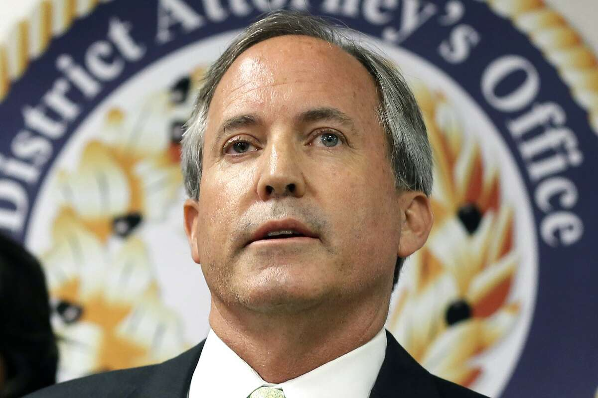 FILE - In this June 22, 2017, file photo, Texas Attorney General Ken Paxton speaks at a news conference in Dallas. Paxton on Monday, Feb. 10, 2020, asked the U.S. Supreme Court to overturn a California law that forbids California state employees using taxpayer-funded business trips to expos or conferences in Texas. California adopted the sanctions in response to a 2017 Texas law allowing foster care and adoption agencies to deny services based on religious beliefs. (AP Photo/Tony Gutierrez, File)