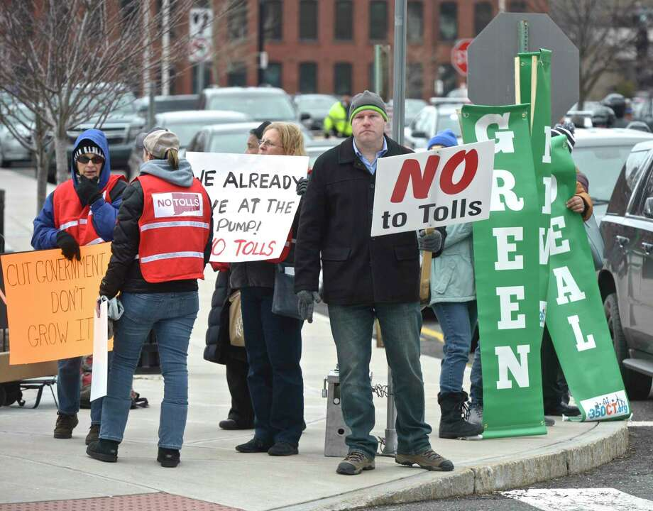 Patrick Sasser, of Stamford, center, was outside of Ned Lamont's Gubernatorial Inauguration in 2019 trying to get the attention a legislators on the subject of highway tolls. Photo: H John Voorhees III / Hearst Connecticut Media / The News-Times