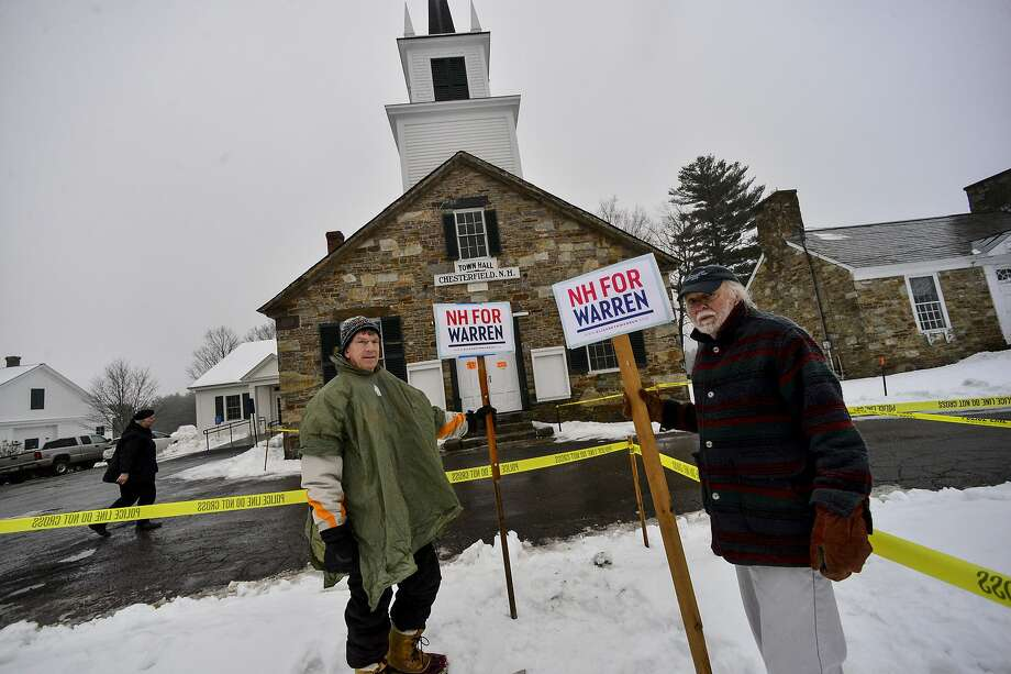 Richard Mellon and Tom Duston hold up signs for Democratic presidential candidate Sen. Elizabeth Warren, D-Mass., outside the Chesterfield, N.H., Town Hall during the New Hampshire presidential primary elections, Tuesday, Feb. 11, 2020. (Kristopher Radder/The Brattleboro Reformer via AP) Photo: Kristopher Radder / Associated Press