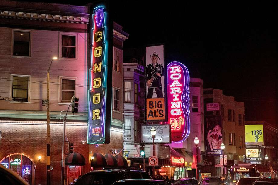 The illuminated sign advertises the Condor Club on the corner of Broadway and Columbus Avenue in North Beach. Photo: Jessica Christian / The Chronicle