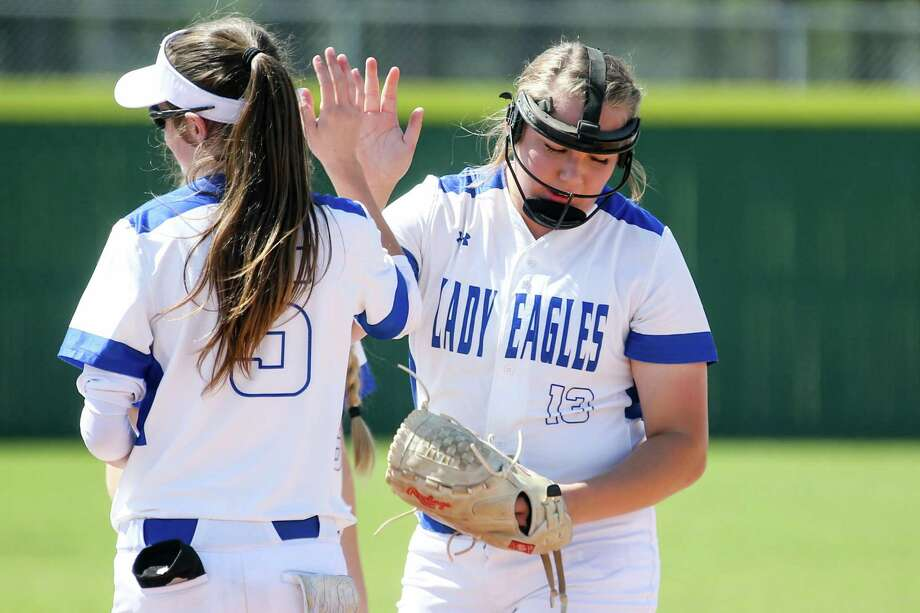New Caney pitcher Bailee Weaver, right, and outfielder Erin Plunkett will be key contributors for the Lady Eagles this season. Photo: Michael Minasi, Staff Photographer / Houston Chronicle / © 2018 Houston Chronicle