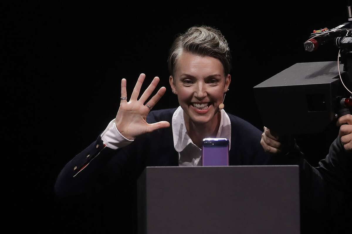 Rebecca Hirst, head of UK Mobile Product Development, demonstrates using a Samsung Galaxy Z Flip Phone while speakin at the Unpacked 2020 event in San Francisco, Tuesday, Feb. 11, 2020. (AP Photo/Jeff Chiu)