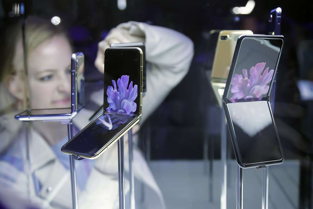 Samsung Galaxy Z Flip Phones are displayed at the Unpacked 2020 event in San Francisco, Tuesday, Feb. 11, 2020. (AP Photo/Jeff Chiu)