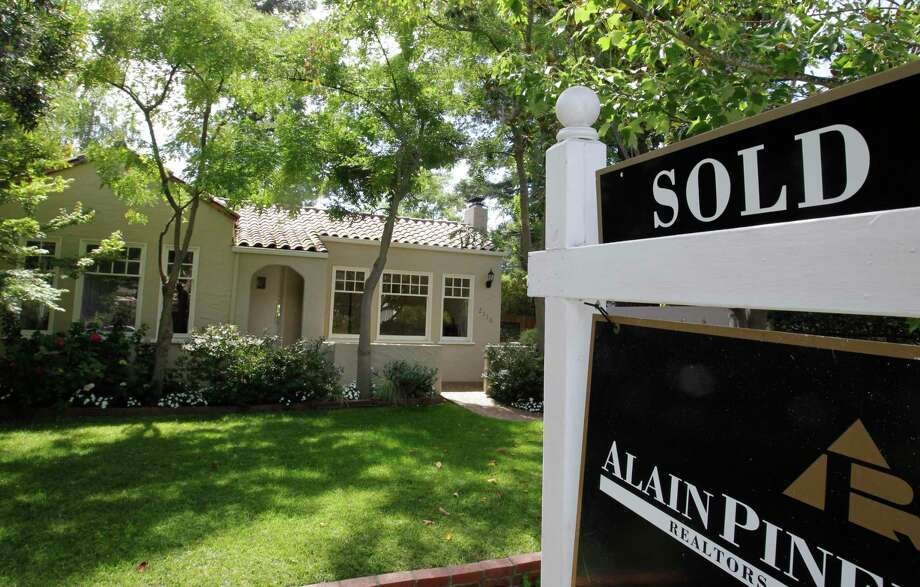 This file photo, shows an exterior view of a sold home. Mortgage rates have fallen to an all-time low, according to Freddie Mac. But not everyone can benefit. (AP Photo/Paul Sakuma) Photo: Paul Sakuma, STF / AP / AP2012