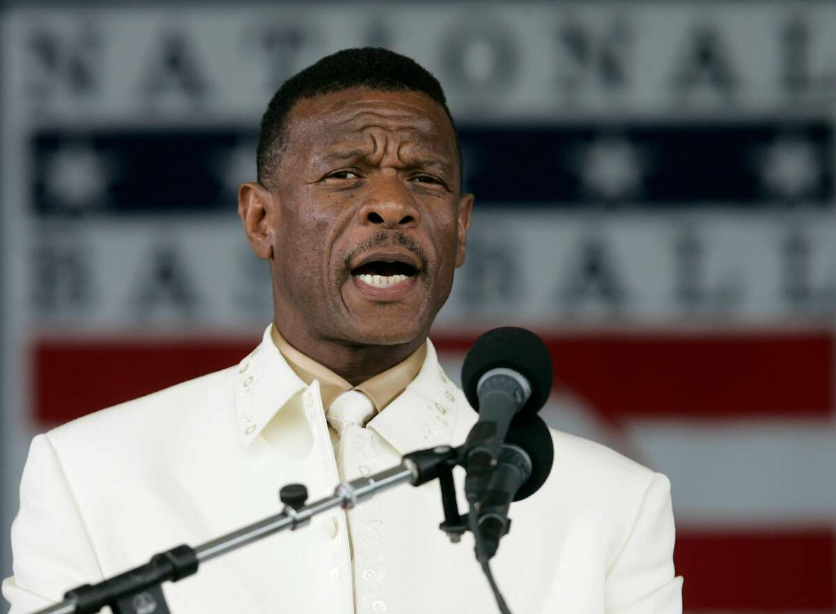 Rickey Henderson delivers his induction speech at the Baseball Hall of Fame in Cooperstown, N.Y., Sunday, July 26, 2009. (AP Photo/Mike Groll)
