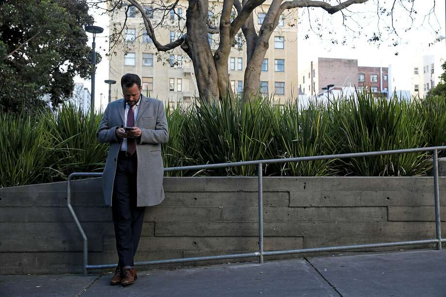 San Francisco District 6 Supervisor Matt Haney checks his phone while standing in Boeddeker Park, located at 246 Eddy Street, in San Francisco, Calif., on Friday, February 7, 2020. Since entering City Hall last year, Haney has quickly emerged as one of the most visible and active supervisors. Photo: Yalonda M. James / The Chronicle