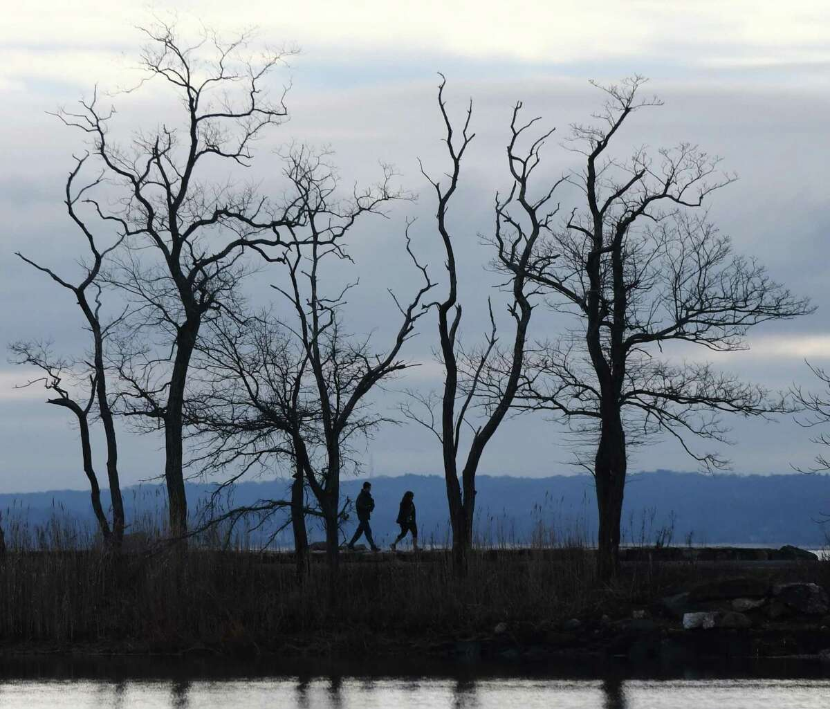 File photo: Folks walk along the water at Greenwich Point Park in Old Greenwich, Conn. Tuesday, Dec. 31, 2019.