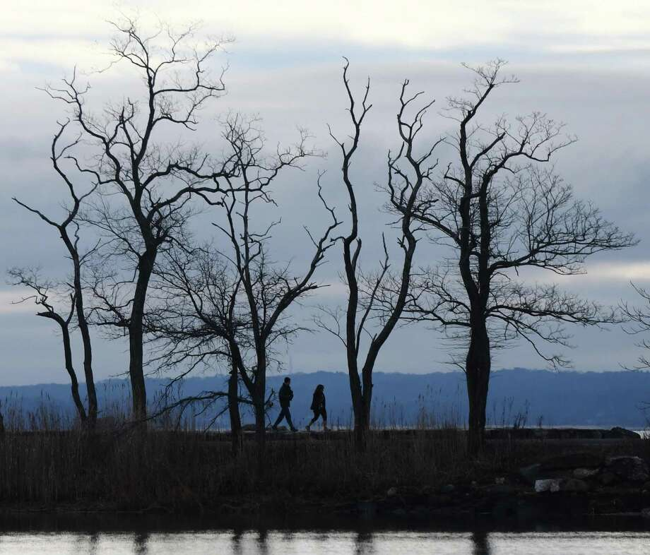 Folks walk along the water at Greenwich Point Park in Old Greenwich, Conn., on Tuesday, Dec. 31, 2019. Photo: Tyler Sizemore / Hearst Connecticut Media / Greenwich Time
