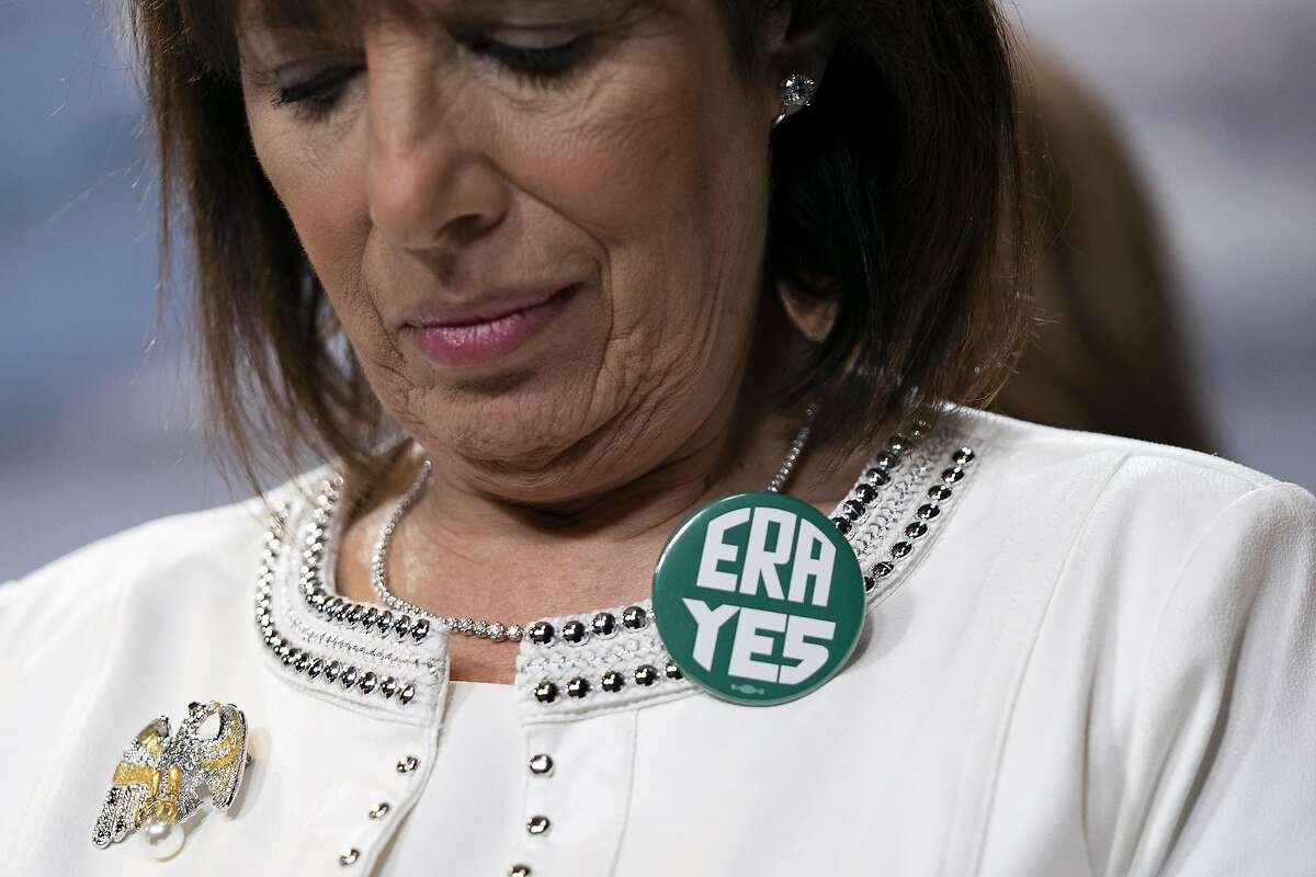 WASHINGTON, DC - FEBRUARY 04: U.S. Rep. Jackie Speier (D-CA) wears a button showing support for passage of the Equal Rights Amendment as she waits to speak during a news conference with members of the Democratic Women's Caucus prior to State of the Union