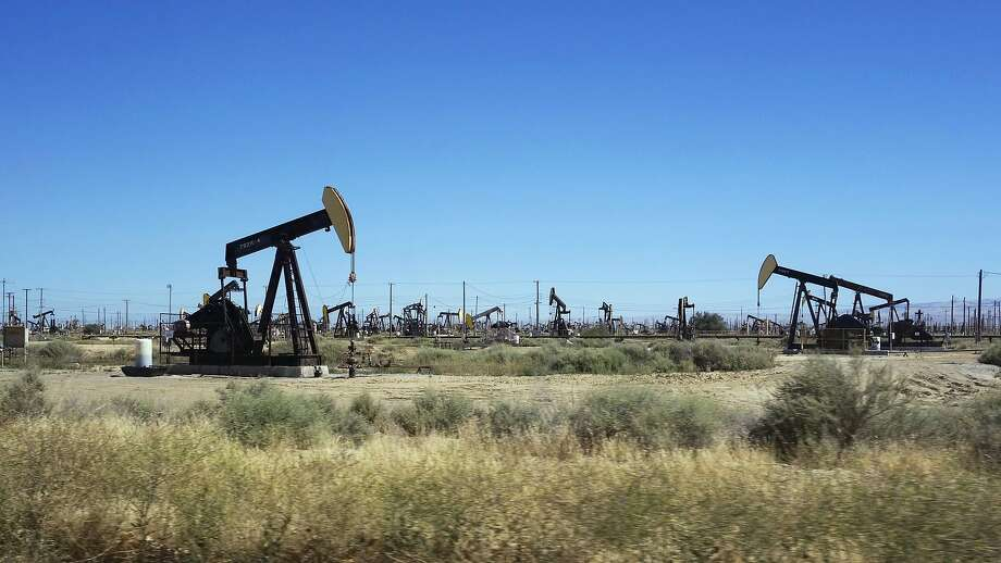 FILE - This June 12, 2017 file photo shows pumpjacks operating in the western edge of California's Central Valley northwest of Bakersfield. Oil production from federally-managed lands and waters topped a record 1 billion barrels in 2019, according to the Department of Interior on Tuesday, Feb. 11, 2020. (AP Photo/Brian Melley, File) Photo: Brian Melley, Associated Press