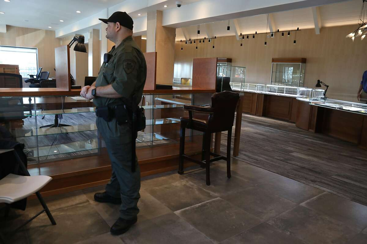 A security guard keeps Witter Coins secure at the old International House of Pancakes on Monday, Feb. 10, 2020, in San Francisco, Calif.