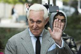 """FILE - In this Nov. 7, 2019 file photo, Roger Stone arrives at Federal Court for his federal trial in Washington. The Justice Department said Tuesday it will take the extraordinary step of lowering the amount of prison time it will seek for Roger Stone, an announcement that came just hours after President Donald Trump complained that the recommended sentence for his longtime ally and confidant was """"very horrible and unfair."""" (AP Photo/Cliff Owen)"""
