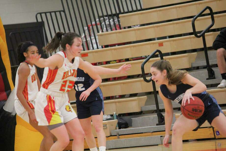 Ferris Mallory McCartney (230 focuses on defense in woemns; basketball action on Saturday at Wink Arena against Northwood. (Pioneer photo/John Raffel)