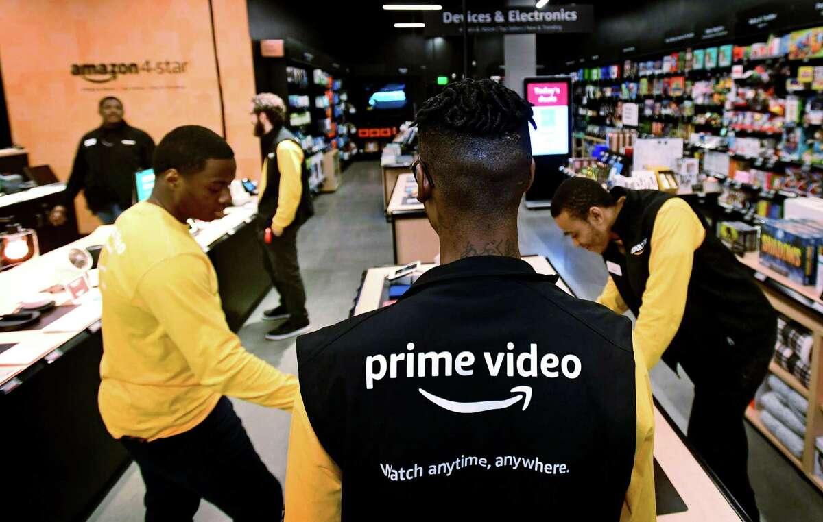 Amazon employees at the first Amazon 4-star store in Connecticut slated to open Wednesday, February 12, 2020, at the SoNo Collection mall in Norwalk, Conn. Amazon 4-star stores are stocked with a selection of highly rated products from Amazon.com that are continually rotated according to their popularity.