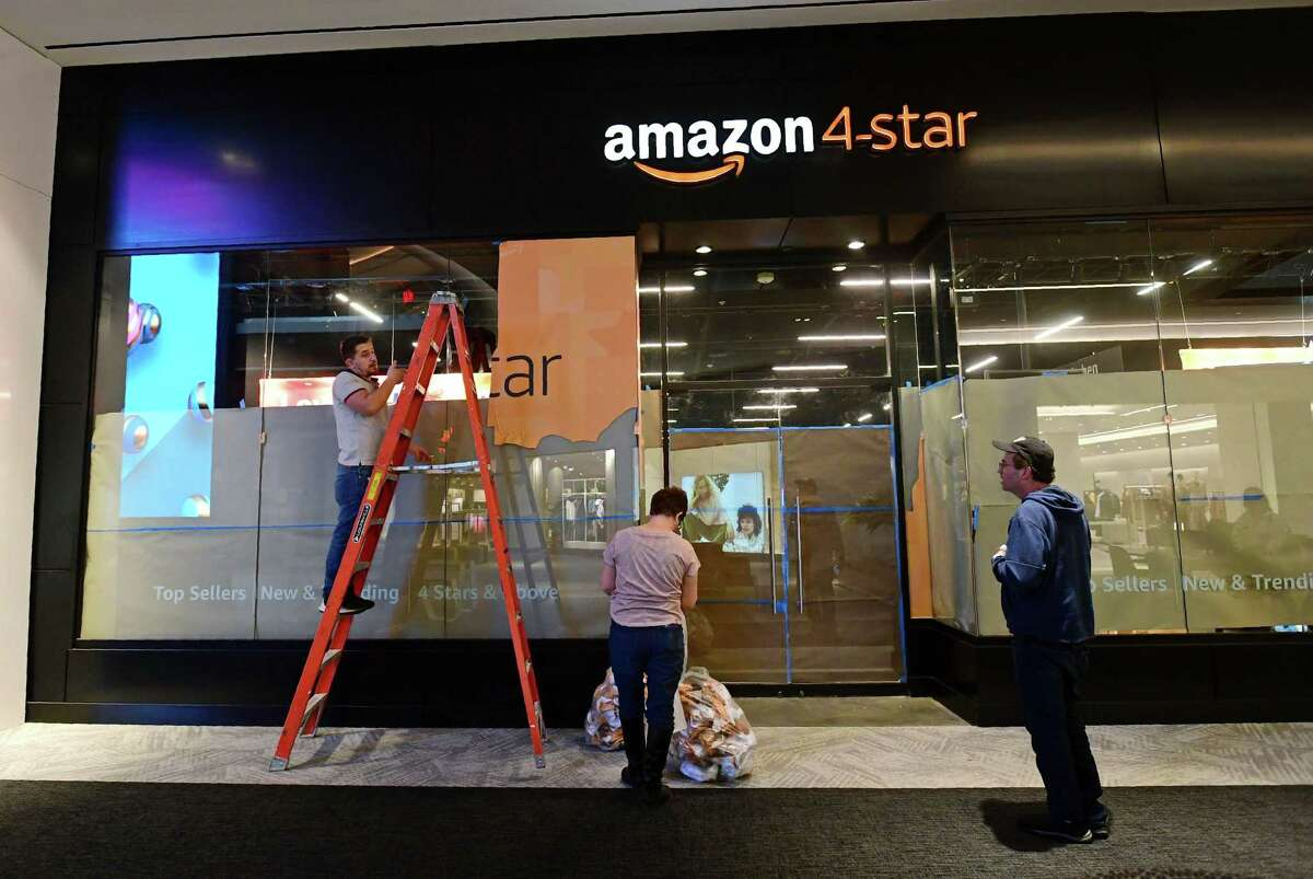 Workers put the finishing touches on the first Amazon 4-star storefront in Connecticut on Tuesday, February 11, 2020, at The SoNo Collection mall in Norwalk, Conn. Amazon 4-star stores are stocked with a selection of highly rated products from Amazon.com that are continually rotated due to their popularity.