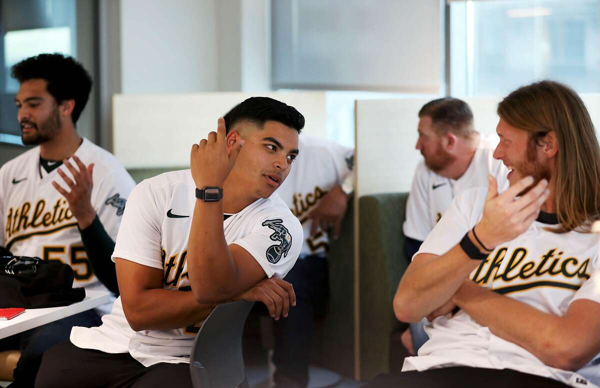 Jesus Luzardo, pitcher, left, converses with A.J. Puk, pitcher, during the Oakland A's pre-Fan Fest media availability at the A's offices at Jack London Square in Oakland, Calif., on Friday, January 24, 2020.