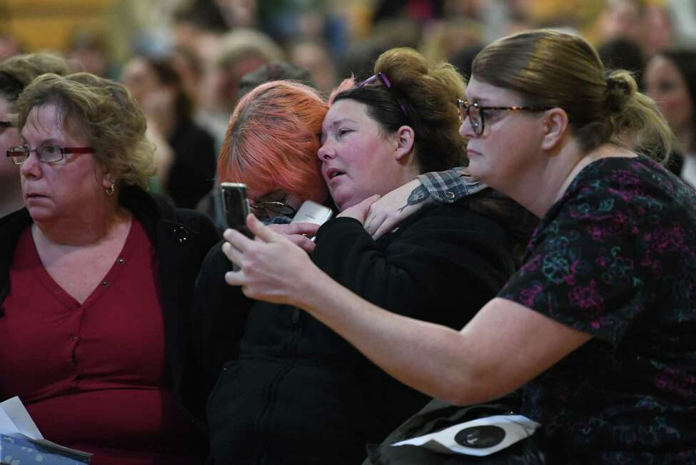 Family members of Brandon Sylvester are consoled as a candlelight vigil is held in the Heatly School gym for students killed and injured in a crash over the weekend on Tuesday, Feb. 11, 2020 in Green Island, N.Y. (Lori Van Buren/Times Union)