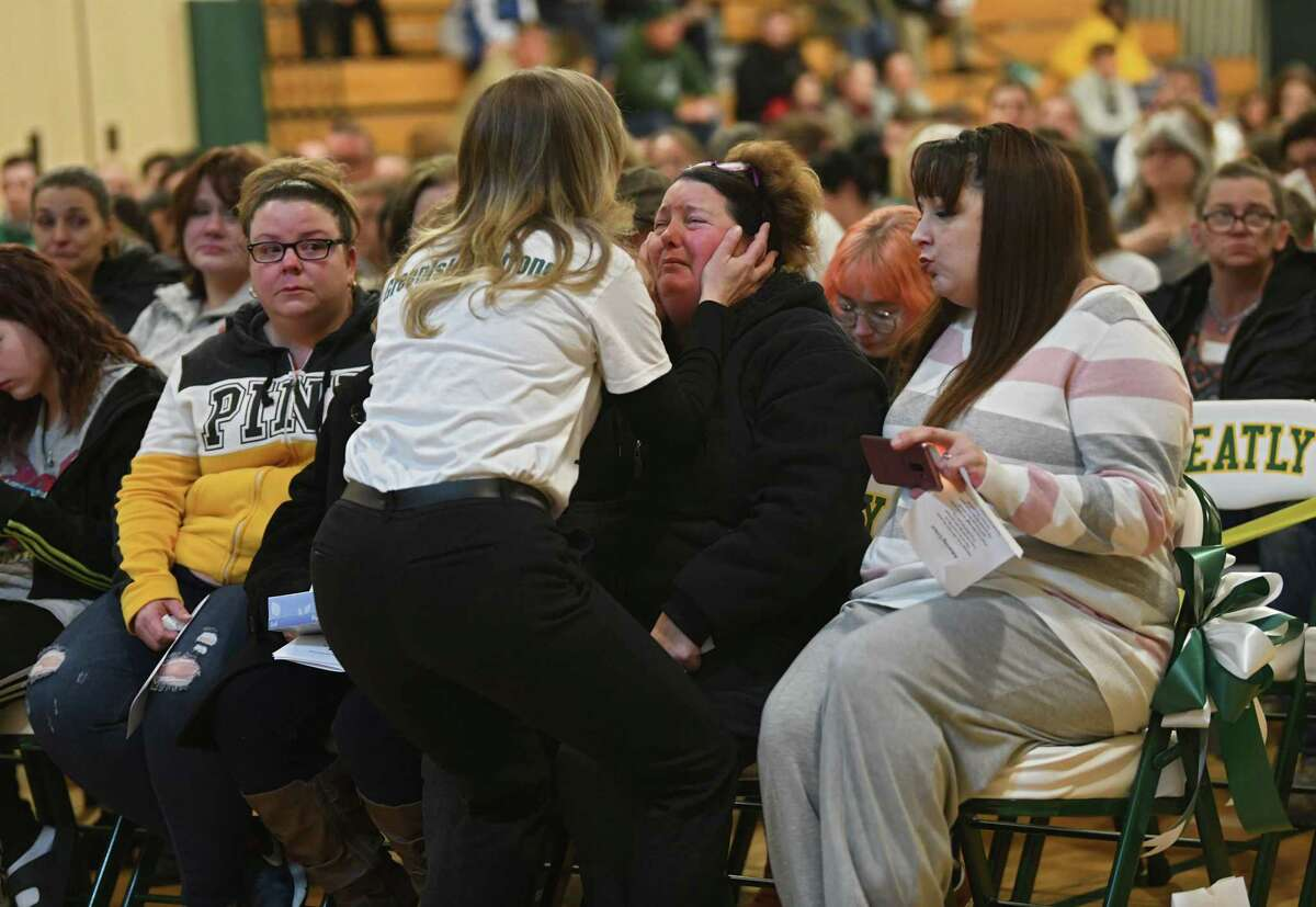 Superintendent Kimberly Ross consoles a family of Brandon Sylvester as a candlelight vigil is held in the Heatly School gym for students killed and injured in a crash over the weekend on Tuesday, Feb. 11, 2020 in Green Island, N.Y. (Lori Van Buren/Times Union)