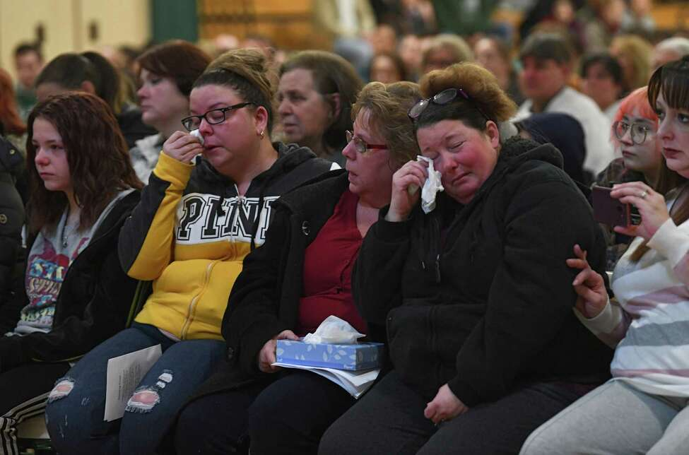 Family members of Brandon Sylvester mourn as a candlelight vigil is held in the Heatly School gym for students killed and injured in a crash over the weekend on Tuesday, Feb. 11, 2020 in Green Island, N.Y. (Lori Van Buren/Times Union)