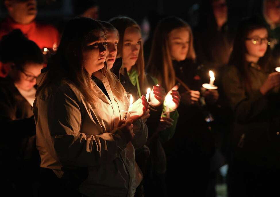 A candlelight vigil is held at gazebo near the Heatly School for students killed and injured in a crash over the weekend on Tuesday, Feb. 11, 2020 in Green Island, N.Y. (Lori Van Buren/Times Union)