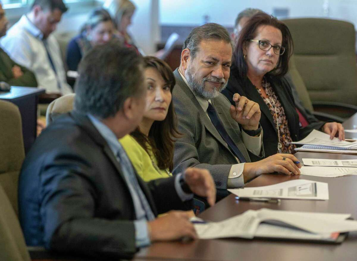 District Judge Ron Rangel, center, speaks Wednesday, Jan. 29, 2020 during the first meeting of the county's nine-member Magistrate Oversight Committee,