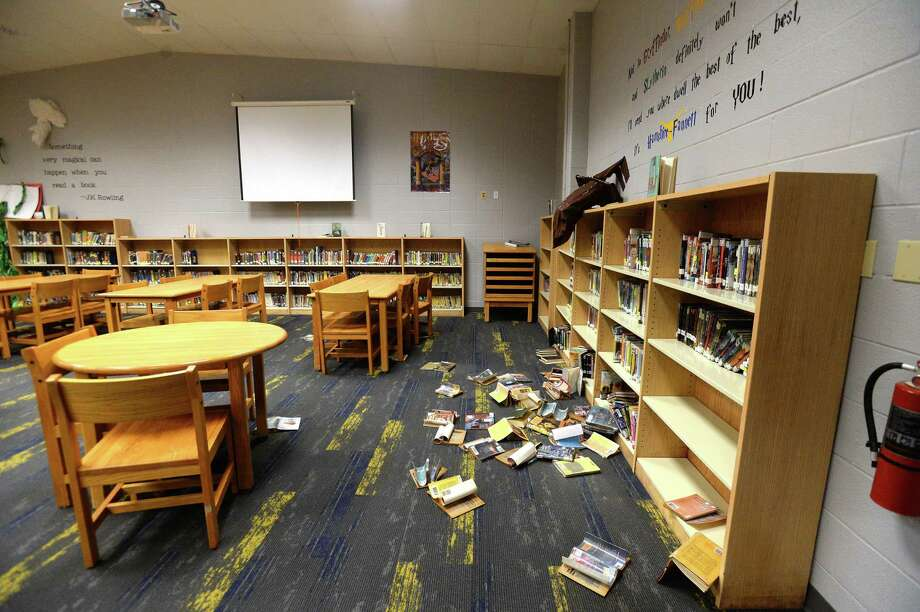 """Hamshire-Fannett Superintendent Dwaine Augustine shows the damage to the Intermediate school building, which along with the middle school flooded after Imelda's heavy rainfall. He says the school got about 15"""" of water inside, some of which remained pooling on the floor in spots Wednesday. Photo taken Wednesday, September 25, 2019 Kim Brent/The Enterprise Photo: Kim Brent / The Enterprise / BEN"""