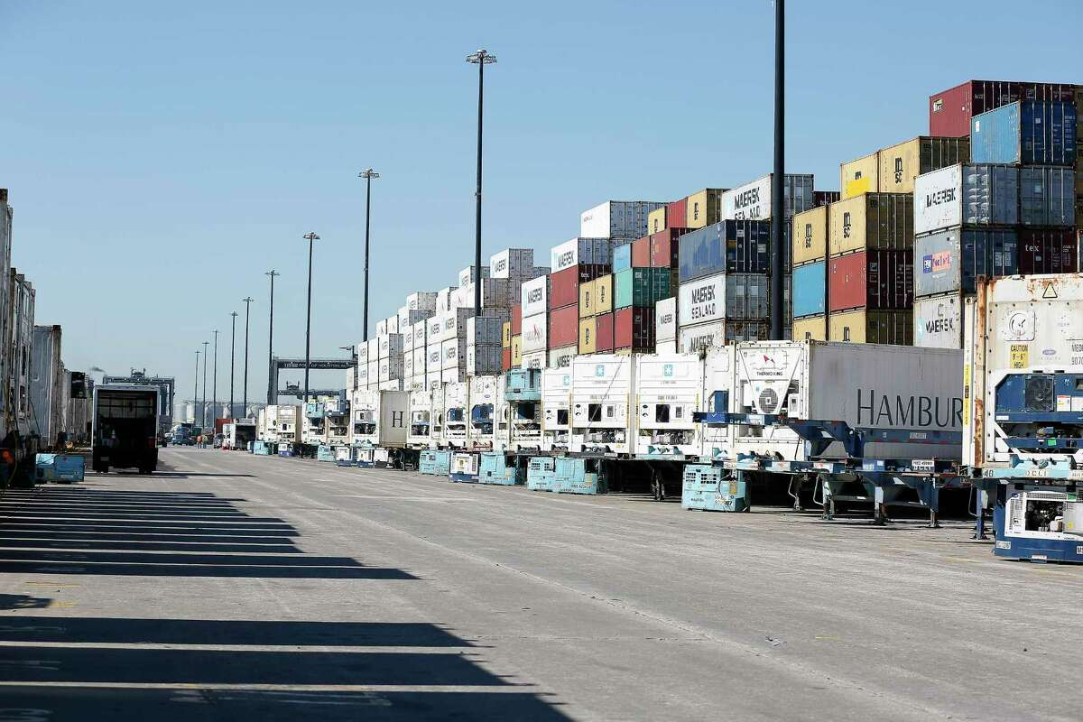 Refrigerated containers line a lane at the Bayport Container Terminal Friday, Jan. 24, 2020, in Houston.