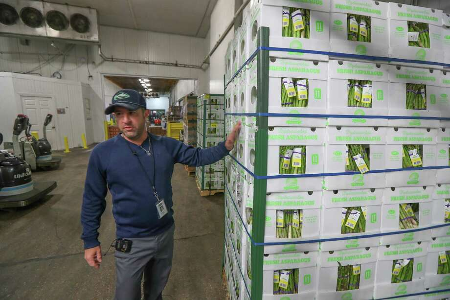 Brent Erenwert, CEO of Houston Cold Storage talks about a pallet of asparagus Friday, Jan. 24, 2020, in Houston. Photo: Steve Gonzales,  Houston Chronicle / Staff Photographer / © 2020 Houston Chronicle