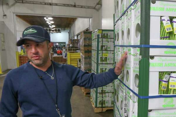 Brent Erenwert, CEO of Houston Cold Storage talks about a pallet of asparagus Friday, Jan. 24, 2020, in Houston.