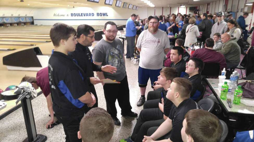 Coach Nelson Chase talks with his Fort Edward boys' bowling team Tuesday, Feb. 11, 2020 after winning the Section II Class C/D championship at Boulevard Bowl. (Pete Dougherty / Times Union)