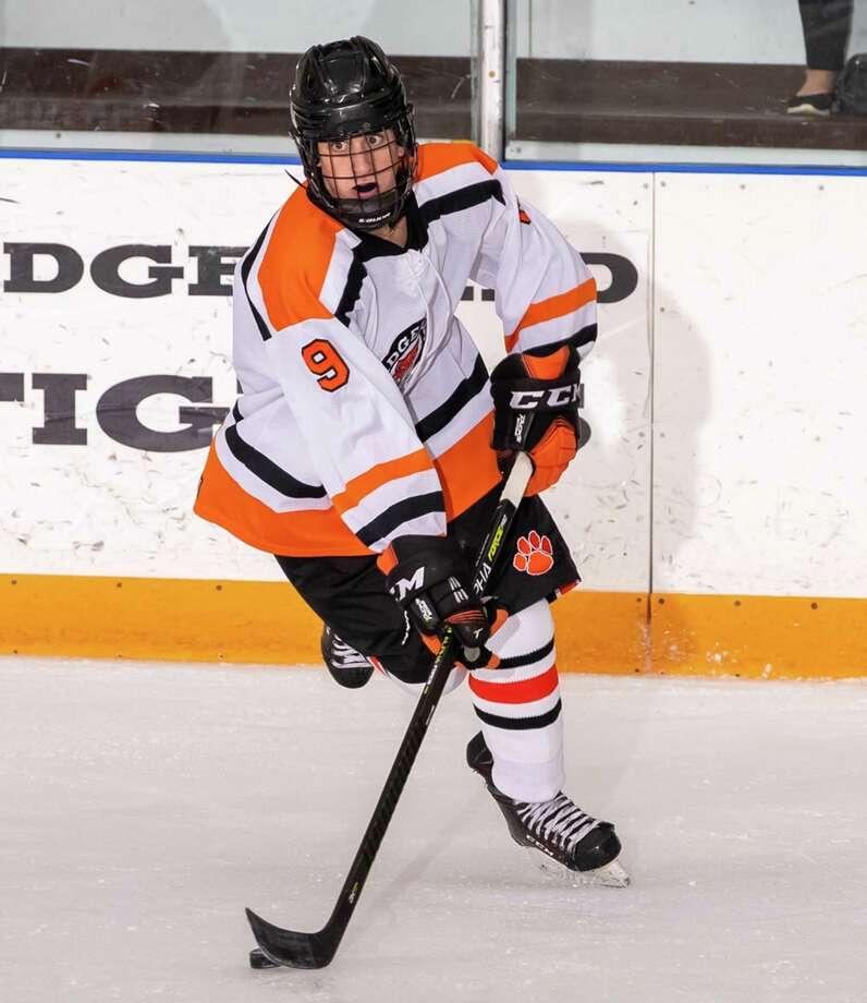 Chris Hamilton and the Ridgefield boys hockey team routed St. Joseph, 8-0, on Monday night. Photo: Gretchen McMahon / For Hearst Connecticut Media