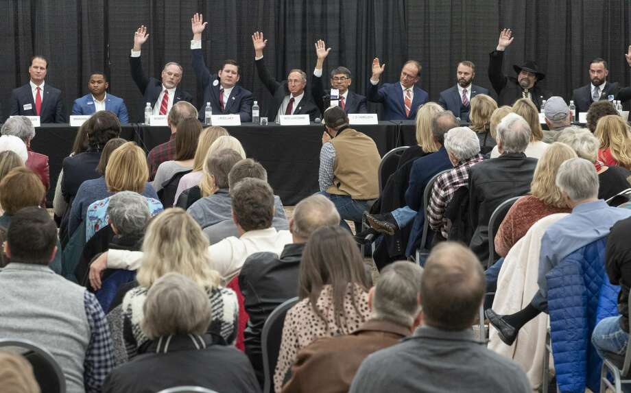 Candidates running for District 11 Congressional seat raise their hands when ask about past votes 02/11/2020 evening at a candidate forum at the Horseshoe Arena Trail. Tim Fischer/Reporter-Telegram Photo: Tim Fischer/Midland Reporter-Telegram