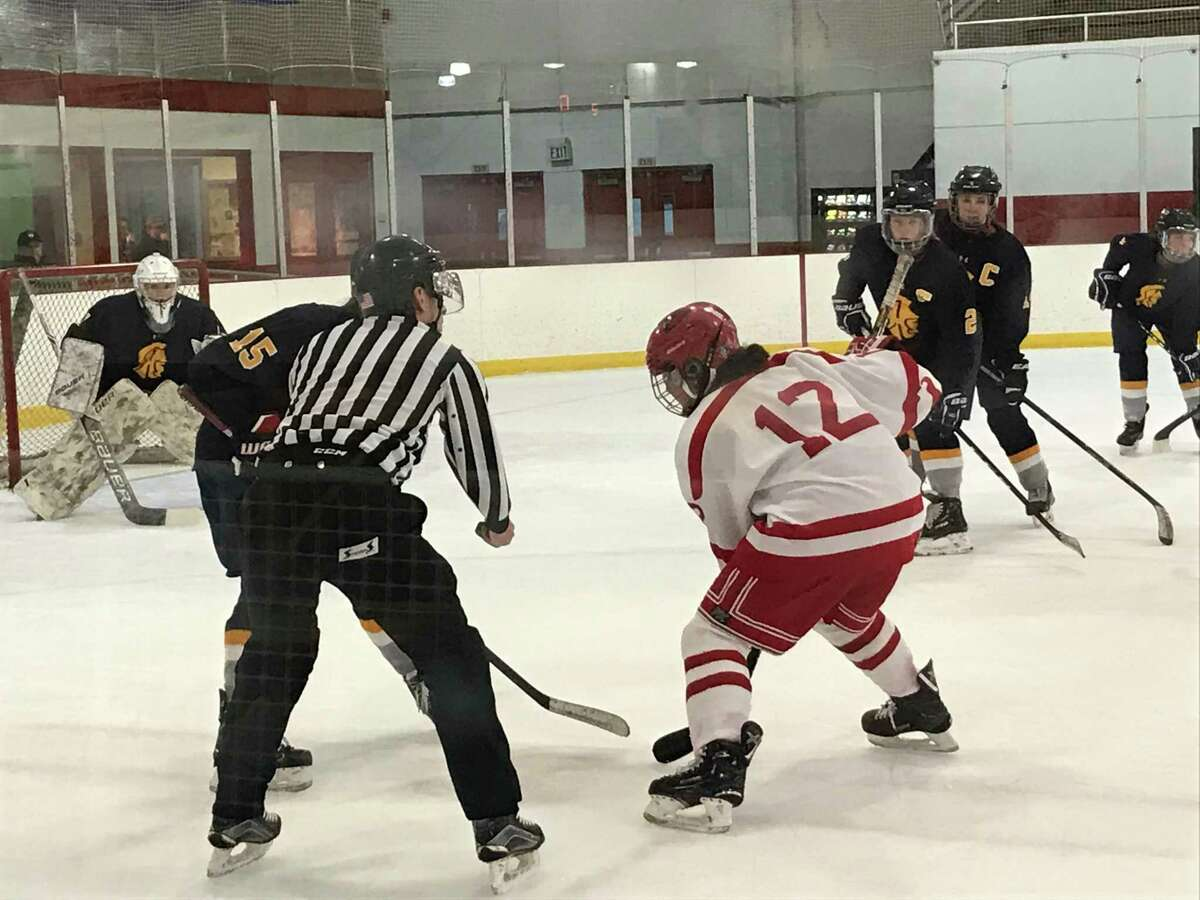 Greenwich's Emma Wingrove takes the faceoff during the Cardinals' girls hockey team's game vs. Simsbury on Tuesday, February 11, 2020, in Greenwich.