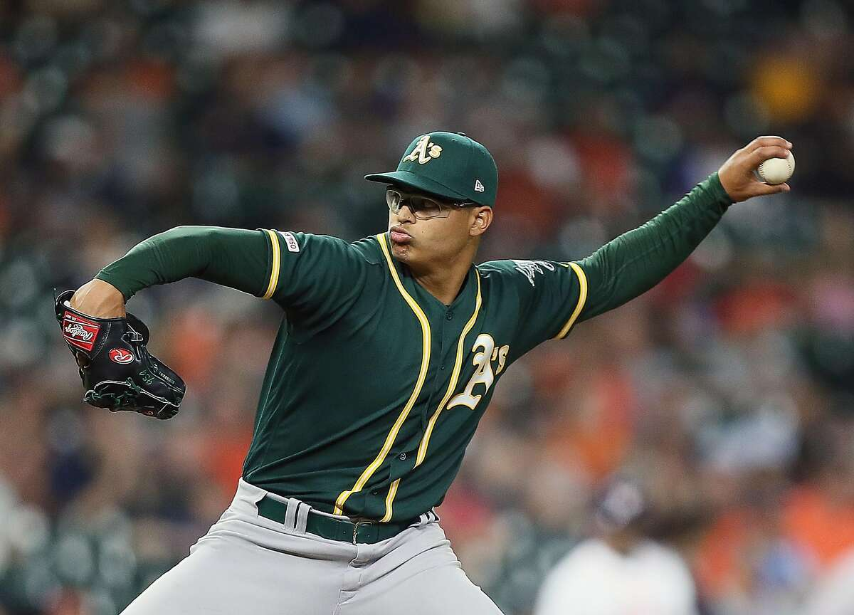 HOUSTON, TEXAS - SEPTEMBER 11: Jesus Luzardo #44 of the Oakland Athletics pitches in the sixth inning against the Houston Astros at Minute Maid Park on September 11, 2019 in Houston, Texas. This was Luzrdo's major league debut. ~~
