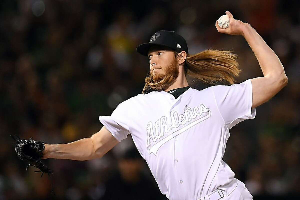 OAKLAND, CA - AUGUST 24: A.J. Puk #31 of the Oakland Athletics pitches against the San Francisco Giants at Oakland Coliseum on Saturday, August 24, 2019 in Oakland, California. (Photo by Jordan Murph/MLB Photos via Getty Images)