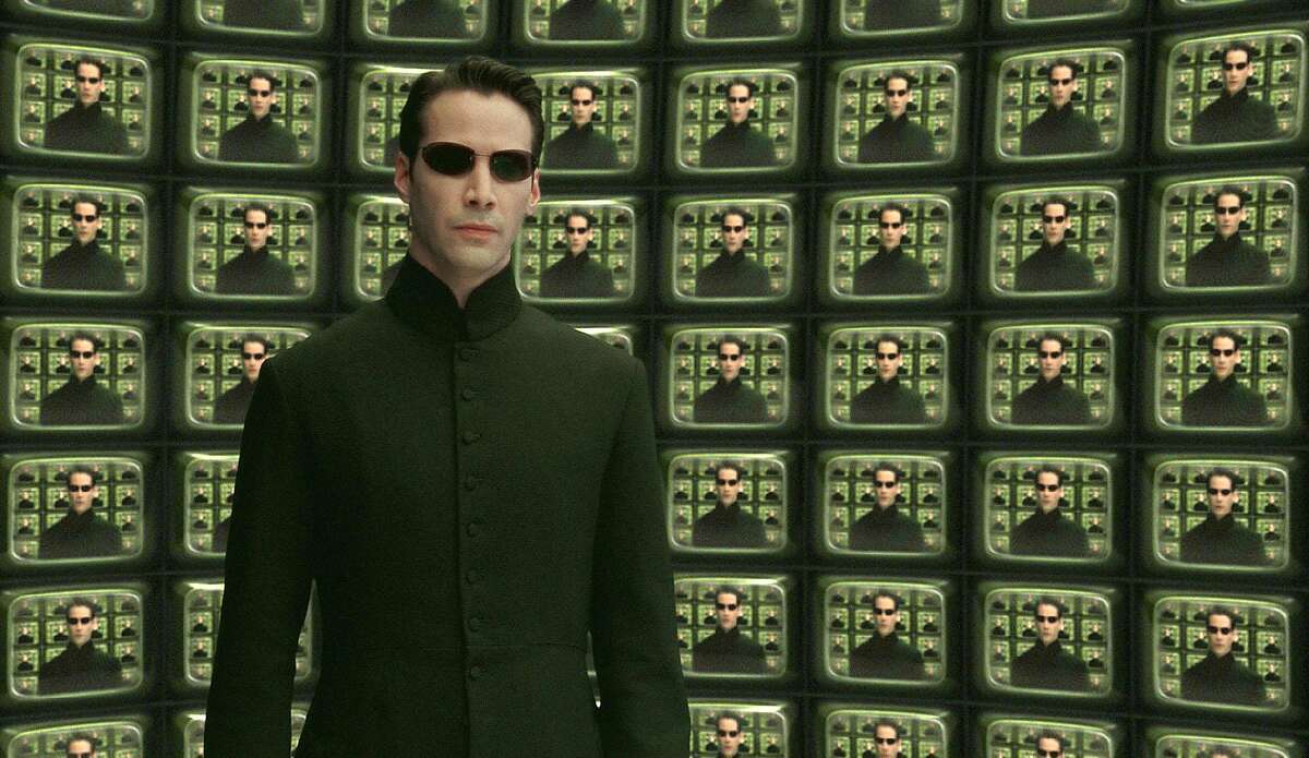 """Actor Keanu Reeves is shown in a scene from Warner Bros. Pictures futuristic action thriller """"The Matrix Reloaded,"""" in this undated promotional photo."""