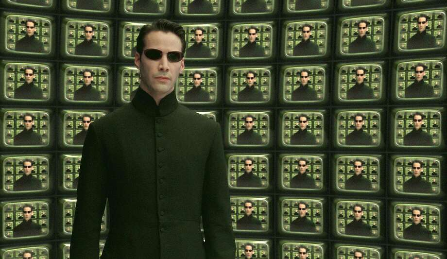 "Actor Keanu Reeves is shown in a scene from Warner Bros. Pictures futuristic action thriller ""The Matrix Reloaded,"" in this undated promotional photo. Photo: AP"