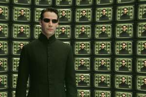 "Actor Keanu Reeves is shown in a scene from Warner Bros. Pictures futuristic action thriller ""The Matrix Reloaded,"" in this undated promotional photo. (AP Photo/Warner Bros. Pictures)"