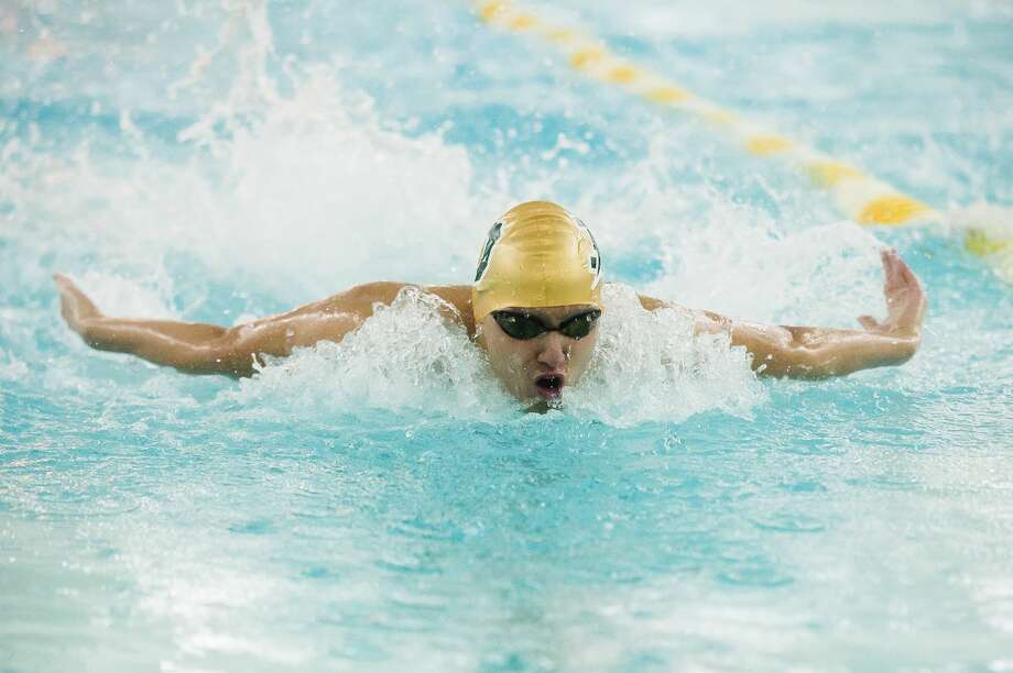 Dow's Collin Che competes in the 100 yard butterfly during a meet against Midland Tuesday, Feb. 11, 2020 at H. H. Dow High School. (Katy Kildee/kkildee@mdn.net) Photo: (Katy Kildee/kkildee@mdn.net)