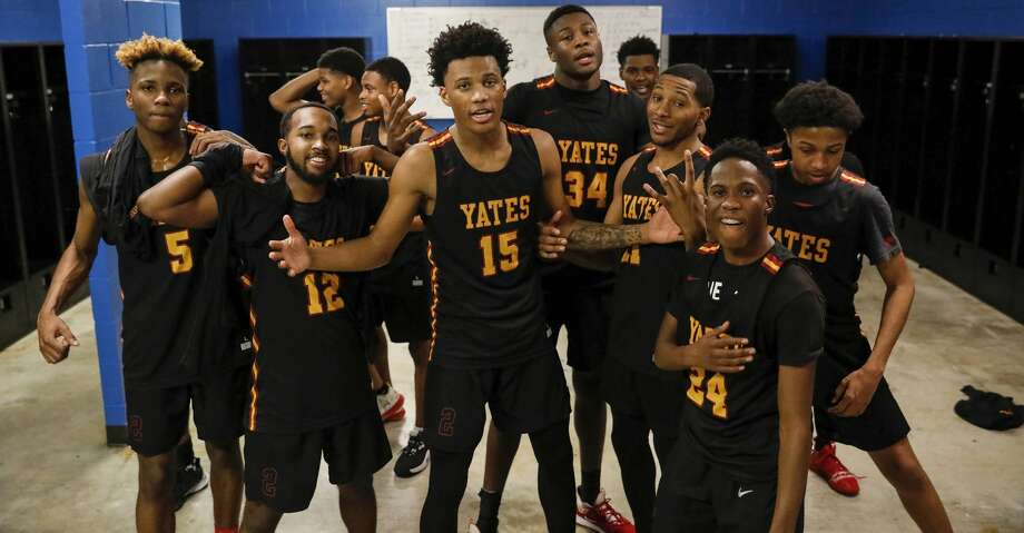 The Yates Lions celebrate in the locker room after the high school basketball game between the between the Yates Lions and the Scarborough Spartans at The Pavilion in Houston, TX on Tuesday, February 11, 2020. Photo: Tim Warner/Contributor